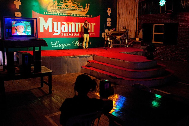 A singer performs on a stage in a restaurant in Mawlamyine, Myanmar.