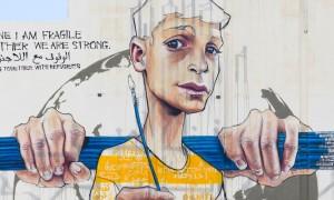 New_Large_Mural_by_HERAKUT_in_Amman_Jordan_2015_header