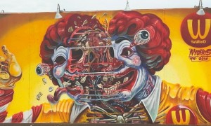 Exploding_Ronald_Awesome_New_Mural_by_Street_Artist_Nychos_for_Coney_Island_Art_Walls_New_York_2016_header