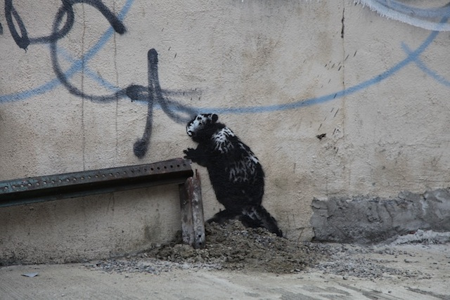 Banksy_in_than_out_NY_10_02