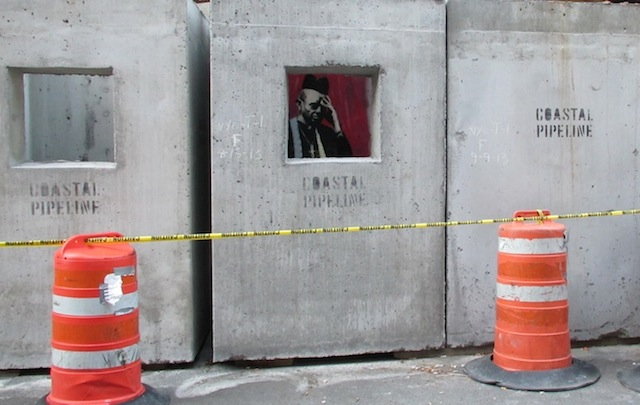 Banksy_in_than_out_NY_12_02