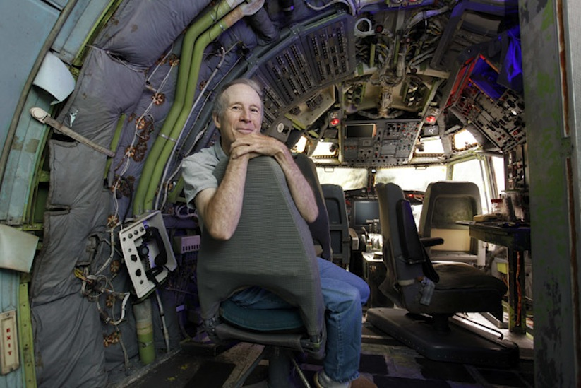 Bruce Campbell sits in the cockpit of his Boeing 727 home in the woods outside the suburbs of Portland, Oregon