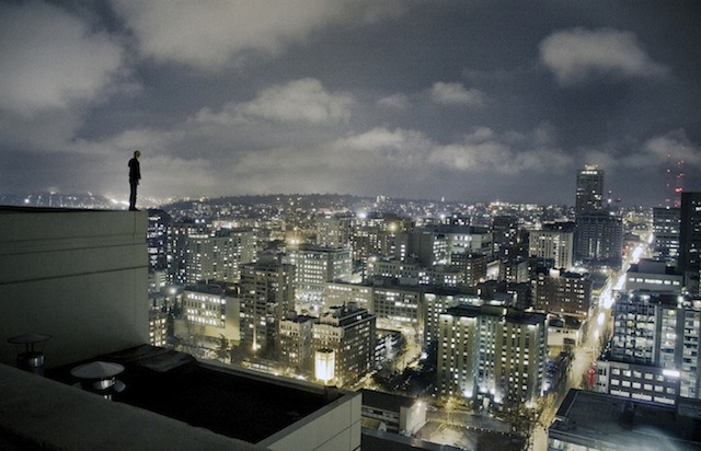 Sparkling Skyline Of Manhattan At Dusk Seen Across Low Rooftop ...